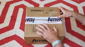 zakupy online : Paris, France - Circa 2019: Man hand closing the cardboard box with Amway Fragile logotype on scotch tape after unboxing Wideo