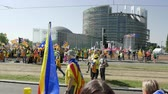 political rally : Strasbourg, France - Jul 2 2019: People holding Catalan flags and placards at demonstration protest front of EU European Parliament against exclusion of three Catalan elected MEPs