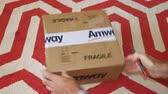 zakupy online : Paris, France - Circa 2019: Man hand unboxing unpacking the Amway cardboard box with foam protection containing multiple household and cosmetics products Wideo