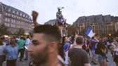 jubel : STRASBOURG, FRANCE - JULY 15, 2018: Algerian French Flag waving Statue Happiness and jubilation of supporters after the victory of the French team in the final of the World Cup football in Russia Stock Footage