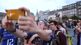 oslava : STRASBOURG, FRANCE - JULY 15, 2018: Friends making selfie dancing celebrating happiness and jubilation of supporters after the victory of the French team in the final of the World Cup football Russia
