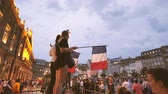 oslava : STRASBOURG, FRANCE - JULY 15, 2018: Young girls with flags jubilation of supporters after the victory of the French team in the final of the World Cup football in Russia against Croatia