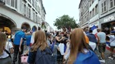 pokale : STRASBOURG, FRANCE - JULY 15, 2018: Walking happy supporters after the victory of the French team in the final of the World Cup football in Russia against Croatia