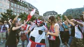 koks : STRASBOURG, FRANCE - JULY 15, 2018: Happiness and jubilation of supporters after the victory of the French team in the final of the World Cup football man drinking Coke wearing ball costume