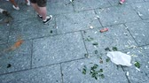 сломал : STRASBOURG, FRANCE - JULY 15, 2018: Above pan over Feets of people walking between broken wine and beer glass bottle after the victory of the French team in the final of the World Cup football