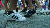 сломал : STRASBOURG, FRANCE - JULY 15, 2018: Feets of people walking between broken wine and beer glass bottle after the victory of the French team in the final of the World Cup football against Croatia