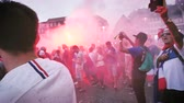 nejlepší : STRASBOURG, FRANCE - JULY 15, 2018: Happiness and jubilation of supporters with distress flare s and smoke grenades after the victory of the French team in the final of the World Cup football