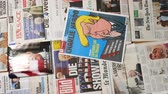 caricatura : Paris, France - Jan 2017: Rotation view from above over multiple international newspaper featuring the election of Donald Trump as a president of united states