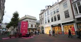 noord holland : Haarlem, Netherlands - Circa 2018: Central Grote Houtstraat street with pedestrians, shops and Foodora App advertising stand stating the launch of the service in the Dutch city