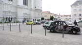 officers : Lyon, France - Circa 2013: Two vintage Citroen 2CV driving in front of Basilique Notre-Dame de Fourviere church place Stock Footage