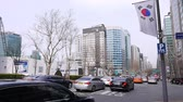 economical : Road traffic at Gangnam district, luxurious cars, bus, taxi passing by