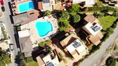 hostel : Aerial Top View on cozy hotel and swimming pool, Crete Stock Footage