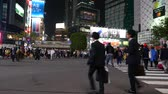 multistory : People start crossing Shibuya intersection, panorama on road and train, Tokyo Japan