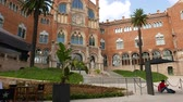 outstanding : Tourist man relax at Hospital de Sant Pau court, Barcelona