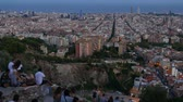 бункер : Time Lapse people enjoy Barcelona aerial panorama from Bunker Del Carmel Стоковые видеозаписи
