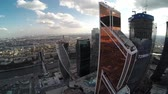 district : Aerial view of Mercury City Tower.Moscow city. Modern architecture buildings. Moscow city Russia from above. Downtown. Glass reflections, concrete and metal. Unique Aerial view drone FPV approach and panorama. Sunny