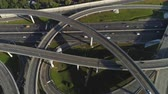 spagetti : Multi-level road interchange and cars traffic. Drone is flying forward, camera is tilting down. Aerial view