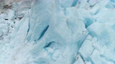 noruega : Blue Nigardsbreen Glacier is Arm of Jostedalsbreen Glacier - the Largest in Europe. Norway. Ice Blocks. Aerial Close-Up View. Drone is Orbiting Around, Camera is Tilting Down Stock Footage