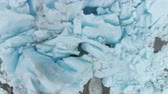 ice block : Blue Nigardsbreen Glacier is Part of Jostedalsbreen Glacier - the Largest in Europe. Norway. Ice Blocks. Aerial Close-Up Vertical Top-Down View