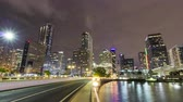 iz : Brickell Key Drive and Miami Downtown at Night. Road Traffic. Time Lapse, United States of America Stok Video