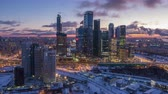 orbiting : Skyscrapers of Moscow City Business Center and City Skyline in Winter Morning Twilight. Russia. Aerial Hyper Lapse. Drone is Orbiting. Establishing Shot