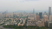 Шэньчжэнь : Shenzhen City at Day. Luohu and Futian District Urban Cityscape. China. Aerial View. Drone Flies Sideways and Upwards