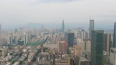 Шэньчжэнь : Shenzhen City at Day. Luohu and Futian District Urban Skyline. China. Aerial View. Drone is Orbiting