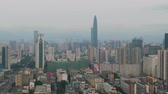 counterclockwise : Shenzhen City. Luohu and Futian District Urban Cityscape. China. Aerial View. Medium Shot. Drone is Orbiting