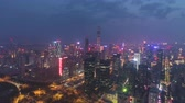 傾き : Shenzhen City Center at Night. Futian District. China. Aerial View. Drone Flies Sideways and Upwards, Tilt Down