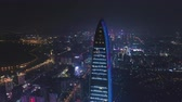 Шэньчжэнь : SHENZHEN, CHINA - MARCH 28, 2019: Kingkey Finance Tower Skyscraper and Cityscape at Night. Aerial View. Drone is Orbiting