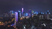 Шэньчжэнь : SHENZHEN, CHINA - MARCH 30, 2019: Urban Skyline and Light Show. Futian District. Aerial View. Reveal Shot. Drone Flies Upwards