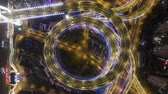 trafik : Illuminated Circular Nanpu Road Junction at Night. Traffic Circle. Shanghai, China. Aerial Vertical Top-Down Hyper Lapse, Time Lapse. Drone Rotation Stok Video