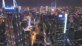 корабли : SHANGHAI, CHINA - MARCH 20, 2018: Shimao International Plaza and Lujiazui Skyline at Night. Aerial View. Drone Flies Forward, Tilt Up.