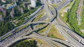freeway interchange : Road Junction and Cars Traffic in Summer Day. Flyover. Aerial Hyper Lapse. Drone is Orbiting Stock Footage