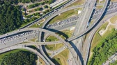 freeway interchange : Road Junction and Cars Traffic in Summer Day. Flyover. Aerial Vertical Top-Down Hyper Lapse. Drone Rotation