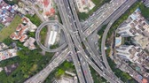budynki : Complex Highway Interchange in Guangzhou in Day, China. Aerial Vertical Top-Down Hyper Lapse, Time Lapse. Car Traffic. Drone Rotation
