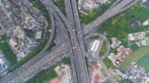 budynki : Complex Highway Interchange in Guangzhou in Day, China. Aerial Vertical Top-Down View. Car Traffic. Drone Rotation