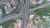 Complex Highway Junction in Guangzhou in Day, China. Aerial Vertical Top-Down View. Car Traffic. Drone Rotates and Flies Downwards