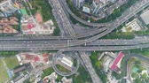 budynki : Complex Road Overpass in Guangzhou in Day, China. Aerial Vertical Top-Down View. Car Traffic. Drone Rotates and Flies Upwards