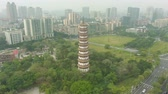 dumanlı sis : Chigang Pagoda in Guangzhou City. Guangdong China. Aerial View. Drone is Orbiting Stok Video