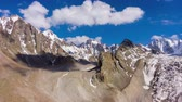 sombras : Tian Shan Mountains and Blue Sky with Clouds. Aerial Hyper Lapse, Time Lapse. Drone Flies Sideways and Upwards Stock Footage
