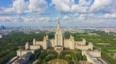 Moscow State University and Skyline at Sunny Day. Blue Sky with Clouds. Russia. Aerial Hyper Lapse, Time Lapse. Drone Flies Backwards and Upwards