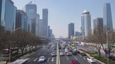 Пекин : BEIJING, CHINA - MARCH 15, 2019: Central Business District at Clear Day. Skyscrapers and Car Traffic on Road