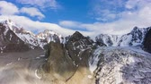 sombras : Tian Shan Mountains and Blue Sky with Clouds. Aerial Hyper Lapse, Time Lapse. Drone Flies Forward