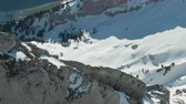 aerial shot : Mountain Rocky Ridge. Swiss Alps, Switzerland. Aerial View. Drone Flies Forward, Tilt Down