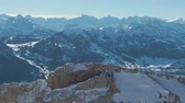 orbiting : Mountain Top at Sunny Winter Morning. Swiss Alps, Switzerland. Aerial View. Drone is Orbiting Stock Footage
