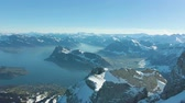 vrcholy : Mount Pilatus, Lake Lucerne and Blue Mountains in Sunny Winter Morning. Swiss Alps, Switzerland. Aerial View. Drone Flies Backwards