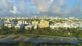 ascending : Miami Beach and Miami Downtown at Sunny Morning. Urban Skyline. Aerial View. United States of America Stock Footage