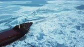 экспедиция : Aerial view. The ship sails through the sea ice in the winter, close-up