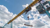 gantry : Girder gantry crane moves at construction site. Moving clouds. Stock Footage